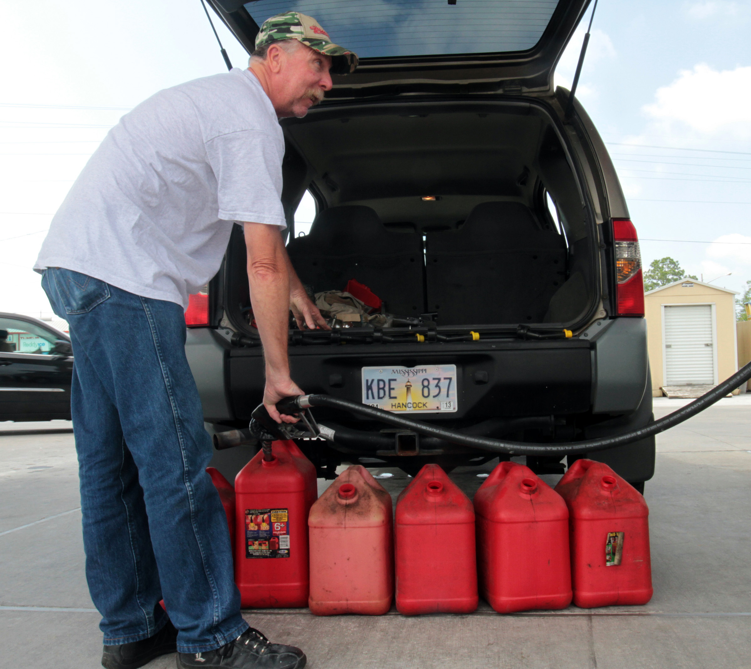 J.D. Wood of Bay St. Louis, Mississippi, fills gas cans for his boat at the Walmart in Waveland, Mississippi, on Wednesday, May 9, 2012. (John Fitzhugh/Biloxi Sun Herald