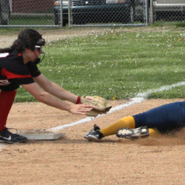 Sophomore Brittany Moore slides into base just in time and is called safe. |Photo by Michaela Post