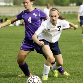 Freshman Riley Caswell defends the ball. |Photo by Linn Benham