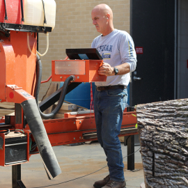 Mr.Smith shows students how to cut wood |Photo by Benham