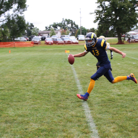 Evan Morris of the eighth grade youth football team breaks away for a touchdown. | Photo by Hannah Davis