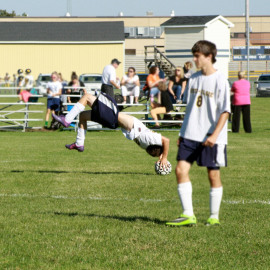 Freshman, Dawson Coats practicing throwing the ball with a front flip, to one of his teammates.|Photo by: Jordan Deming