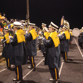 Even off the field, the band pumps up the crowd. | Photo by Lindsey Benham