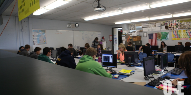 Students work in one of teacher Bonnie Ott's business classes. | Photo by Brittany Moore