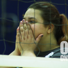 Eighth grade volleyball player, Makel Bush, taking a moment to gather herself after a tough play. | Photo by Sabreena Soliz