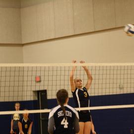 Freshman, Emma Samson blocking against the opposing teams attack. |Photo by: Miranda Chapman
