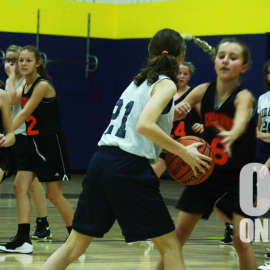 Ovid Elsie Middle School faces Chesaning in girls basketball on the 10th. Number 21 looks for an opening to score of point for her team. |Photo by A.J Larsen
