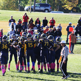 8th grade boys huddle up before their next play. |Photo by Hannah Davis