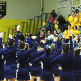 The Varsity Cheer team pumps up the crowd before their Competition | Photo by Michaela Post
