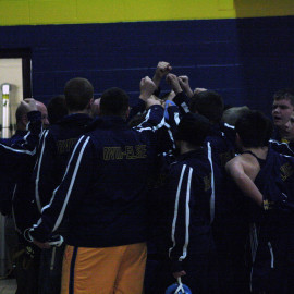 The middle school wrestling team huddles before their meet. |Photo by Molly Maynard