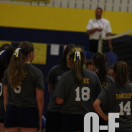 The 8th grade girls circling around their coach discussing what their next move is. |Photo by Mikyala Baese