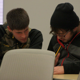 Juniors Clayton Alaga(left) and Kyle Wending(right) concentrate on their competition questions for Science Olympiad. | Photo by Molly Maynard