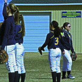 The O-E Varsity softball girls practice there throwing skills before the game. |Photo by A.J Larsen