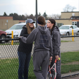 1st Doubles Grace Samson and Danyelle Frink discuss strategies with Coach Miller.| Photo by Molly Maynard